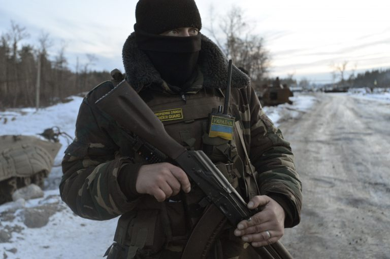 A Ukrainian serviceman stands guard at his position in the village of Luhanska, Luhansk region January 24, 2015. Eastern Ukraine has seen an escalation of fighting in recent days that Russian President Vladimir Putin has blamed on Kiev. The rebels have ruled out more peace talks. Ukrainian President Petro Poroshenko, pledging to protect Ukrainian territory, said he would convene an emergency meeting of his country's security council on Sunday. REUTERS/Oleksandr Klymenko (UKRAINE - Tags: CIVIL UNREST MILITARY POLITICS CONFLICT) - RTR4MRGC