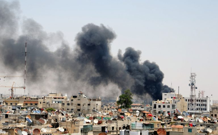A picture released by the official Syrian news agency SANA shows smoke rising above Damascus after two huge bombs exploded outside the Palace of Justice in Central Damascus on June 28, 2012.  A police source told AFP on condition of anonymity that two magnetic bombs exploded in two judges' cars in the open-air car park, while a third was in the process of being defused. AFP PHOTO/SANA  == RESTRICTED TO EDITORIAL USE - MANDATORY CREDIT