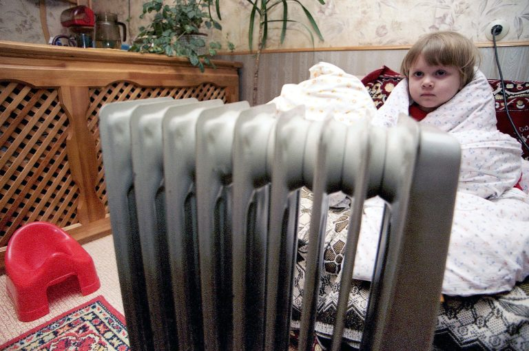 TAS30: IVANOVO REGION, RUSSIA. FEBRUARY 1. An electric heater is of little use (in pic). The Mikhalevo settlement was left without central heating because of the indebtness of the local administration. (Photo ITAR-TASS / Vladimir Smirnov) ----- ÒÀÑ 29 Ðîññèÿ. Èâàíîâñêàÿ îáëàñòü. 01 ôåâðàëÿ. Îáîãðåâàòåëü íå ñïàñàåò îò õîëîäà 3-ëåòíþþ Êàðèíó (íà ñíèìêå). Æèòåëè ïîñåëêà Ìèõàëåâî îñòàëèñü áåç îòîïëåíèÿ èç-çà äîëãîâ ìåñòíîé àäìèíèñòðàöèè ïåðåä ïîñòàâùèêàìè ýíåðãèè. Ôîòî ÈÒÀÐ-ÒÀÑÑ/ Âëàäèìèð Ñìèðíîâ