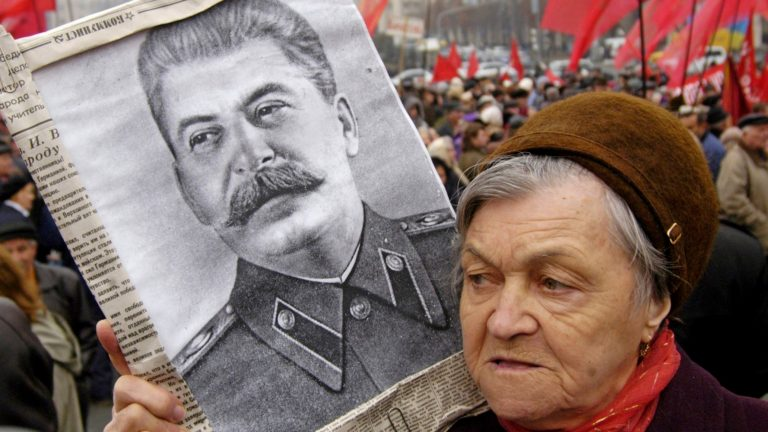 Supporter of the Ukrainian Communist Party  hold a portrait of Joseph Stalin,  during a mass rally marking the 88th anniversary of the Bolshevik revolution on Independence square in Kiev, Ukraine, Monday, Nov. 7, 2005.  Ukraine marks the 88th anniversary ofthe Bolshevik revolution.(AP Photo/Sergei Chuzavkov)