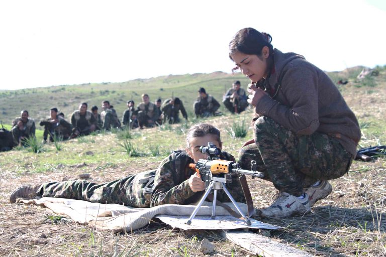 March 25, 2016 - Kurdistan, IRAQ - Women fighters with the Kurdish YPG learn how to use a heavy machine gun during training shown in a propaganda photo released by the YPG March 25, 2016 in Iraqi Kurdistan. The YPG or Peoples Protections Units are fighting the Islamic State in Syria and Iraq. (Credit Image: Global Look Press via ZUMA Press)