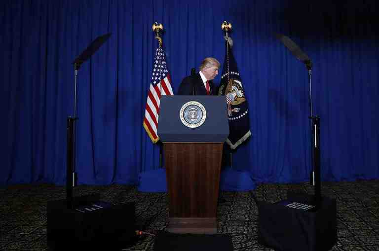 President Donald Trump walks from the podium after speaking at Mar-a-Lago in Palm Beach, Fla., Thursday, April 6, 2017, after the U.S. fired a barrage of cruise missiles into Syria Thursday night in retaliation for this week's gruesome chemical weapons attack against civilians. (AP Photo/Alex Brandon)