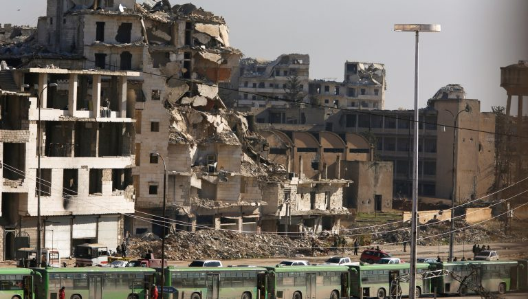 Buses are seen parked in Aleppo's government controlled area of Ramouseh, as they wait to evacuate civilians and rebels from eastern Aleppo, Syria December 15, 2016. REUTERS/Omar Sanadiki