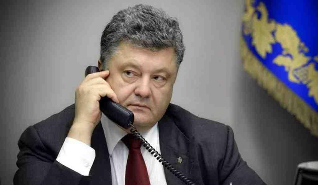 Одни разговоры: Порошенко обсудил сМеркель обмен пленными вДонбассе