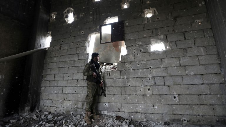 A Turkey-backed Free Syrian Army fighter holds his weapon in the town of Marea in northern Aleppo countryside, Syria February 10, 2018.