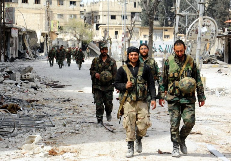 DAMASCUS, March 19, 2018 Syrian soldiers march in the town of Saqba in the capital Damascus' Eastern Ghouta after the army liberated it on March 18, 2018. Syrian President Bashar al-Assad visited Eastern Ghouta on Sunday, as the army has liberated 80 percent of that area from the rebels. (Credit Image: Global Look Press via ZUMA Press)