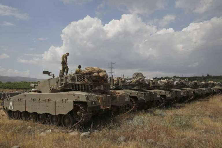 Israeli Merkava Mark IV tanks take position near the Syrian border in the Israeli-annexed Golan Heights on May 9, 2018.  The Israeli-occupied section of the Golan Heights was placed on high alert due to