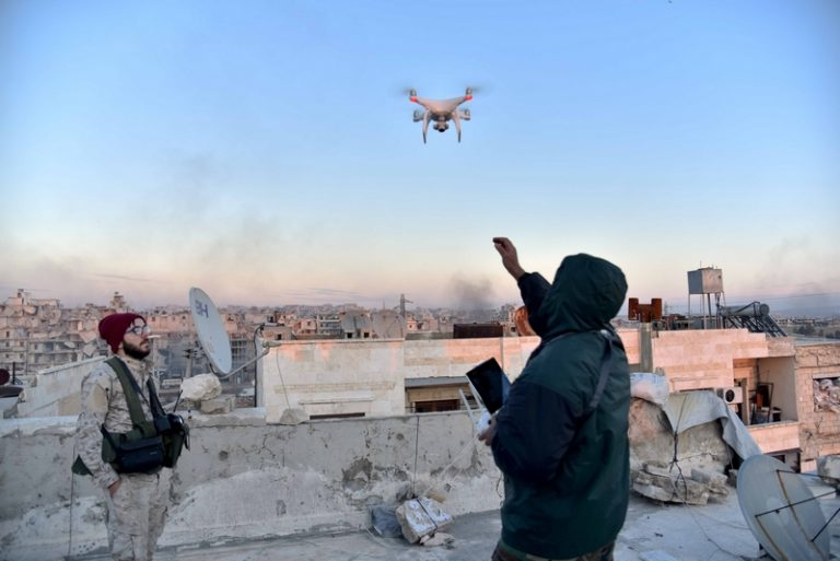 ALEPPO, Dec. 18, 2016 A Syrian government soldier controls a drone to investigate the rebel-held area in Aleppo, Syria on Dec. 18, 2016. Sunday's planned evacuation of rebels from their remaining strongholds in the northern city of Aleppo faced some snags, with the government accusing the rebels of breaching a deal for the second time, a military source told Xinhua. (Credit Image: Global Look Press via ZUMA Press)