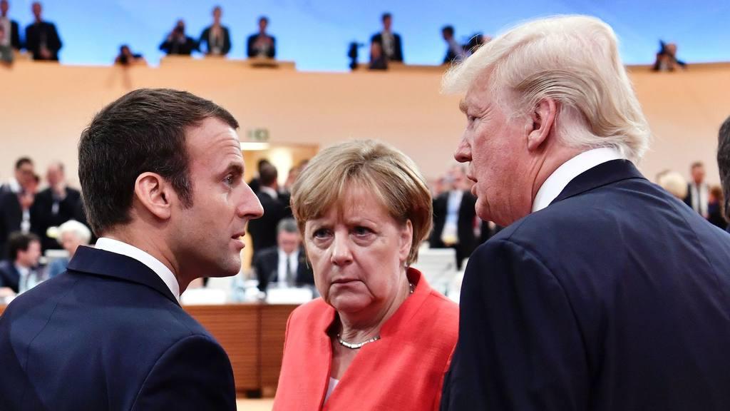 Макрон Меркель и Трамп