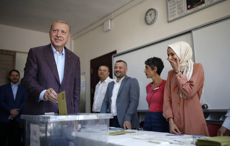 Turkey's President Recep Tayyip Erdogan casts his ballot at a polling station in Istanbul, Sunday, June 23, 2019. Polls have opened in a repeat election in Turkey's largest city where Erdogan and his political allies could lose control of Istanbul's administration for the first time in 25 years. (AP Photo/Emrah Gurel)