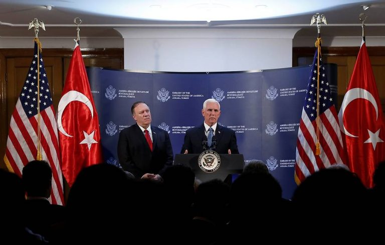 U.S. Vice President Mike Pence speaks during a news conference, as U.S. Secretary of State Mike Pompeo looks on, at the U.S. Embassy in Ankara, Turkey, October 17, 2019. REUTERS/Huseyin Aldemir
