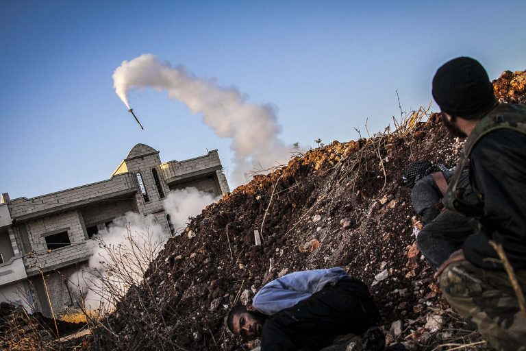 SEPTEMBER 24: In this Friday, Sept. 20, 2013 photo, Free Syrian Army fighters take cover moments after shelling  government forces in Idlib province, northern Syria. (Associated Press)