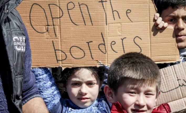 мигранты в лагере для беженцев