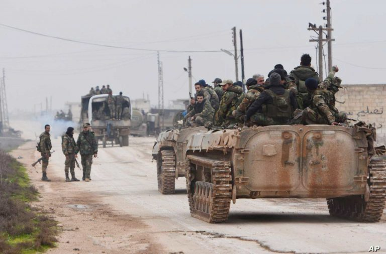 In this photo released Wednesday Feb. 5, 2020 by the Syrian official news agency SANA, shows Syrian government forces entering the village of Tel-Toukan, in Idlib province, northwest Syria. On Thursday, State media and opposition activists said Turkey has sent more reinforcements into northwestern Syria, setting up new positions in an attempt to stop a government offensive on the last rebel stronghold in the war-torn country. (SANA via AP)