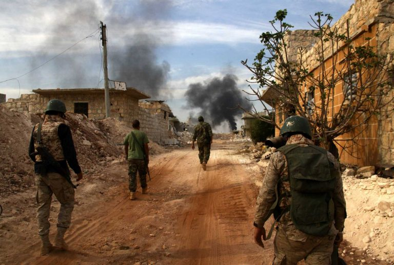 Syrian government forces walk in the strategic area of the Bazo hilltop, north of Khan Tuman on the southern outskirts of the northern embattled Syrian city of Aleppo as they advance in the ongoing offensive to the seize rebel-held eastern part of the city on October 25, 2016.    Government forces and allied fighters are advancing on the southern outskirts of Aleppo, the Syrian Observatory for Humman Rights reported, seizing territory overlooking rebel-held areas.    / AFP PHOTO / GEORGES OURFALIANGEORGES OURFALIAN/AFP/Getty Images