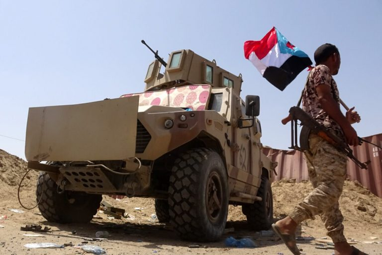 A fighter loyal to Yemen's separatist Southern Transitional Council (STC) holds the separatist flag in the southern Abyan province on May 18, 2020, following a three-hour ceasefire deal between pro-government troops and separatist forces. (Photo by Nabil HASAN / AFP) (Photo by NABIL HASAN/AFP via Getty Images)