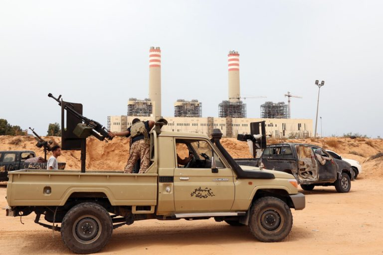 Forces loyal to Libya's UN-backed unity government are seen in front of a power plant they have captured from the Islamic State (IS) group around 23 kilometres (14 miles) west of Sirte on June 2, 2016. According to Libyan officials fighting resumed on June 1 on the outskirts of Sirte between their forces and jihadist during which three pro-government troops had been killed and 10 more wounded. Sirte was the hometown of slain dictator Moamer Kadhafi and, since seizing it in June last year, IS has turned it into a recruitment and training camp.     / AFP / MAHMUD TURKIA        (Photo credit should read MAHMUD TURKIA/AFP via Getty Images)