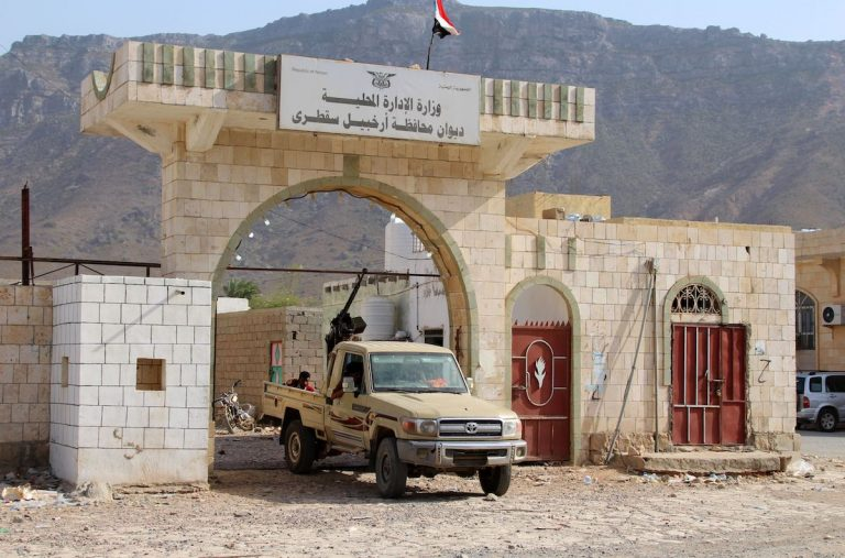 A military vehicle beloging to Yemen's southern separatist forces blocks the entrance at a local administration building on the strategic island of Socotra, on June 22, 2020. - The fall of Socotra on June 21 deepens the crisis between the separatist Southern Transitional Council (STC) and the government after the failure of a power-sharing deal in areas beyond the control of Huthi rebels, who hold the capital Sanaa and much of northern Yemen. The STC, which declared autonomy in southern Yemen on April 26, said it had already begun implementing self-rule on the island. (Photo by - / AFP) (Photo by -/AFP via Getty Images)